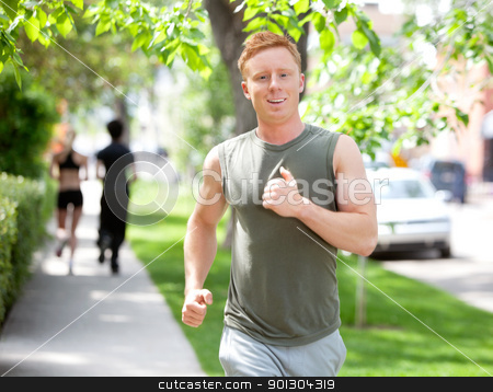 People running on walkway stock photo, Close-up of man running against blur background by Tyler Olson