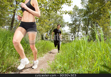 Healthy people jogging in forest stock photo, Friends in fitness clothing running on pathway by Tyler Olson