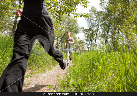 Friends jogging in forest stock photo, Happy men jogging at the park with his friend by Tyler Olson