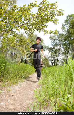 Health conscious people jogging stock photo, Young man jogging with his friends in the background by Tyler Olson