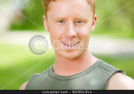 Portrait of a Caucasian man stock photo, Portrait of a Caucasian man smiling against blur background by Tyler Olson