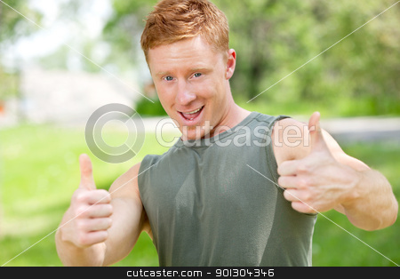 Man showing thumbs-up sign stock photo, Portrait of a man showing thumbs-up sign against blur background by Tyler Olson