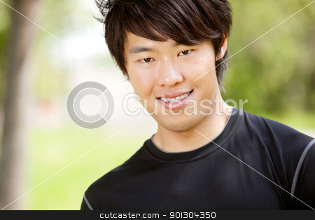Portrait of a young man smiling stock photo, Portrait of a man smiling against blur background by Tyler Olson