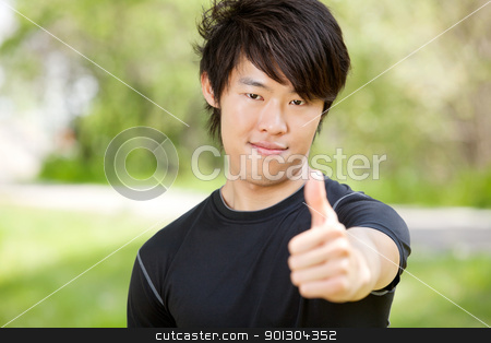 Portrait of a man showing thumbs-up sign stock photo, Portrait of a man showing thumbs-up sign against blur background by Tyler Olson