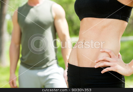Mid section of man and woman stock photo, Mid section of man and woman against white background by Tyler Olson