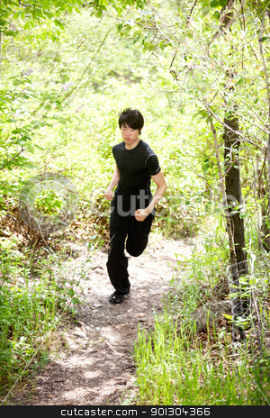 man in sportswear jogging stock photo, Man jogging during morning walk against blur background by Tyler Olson