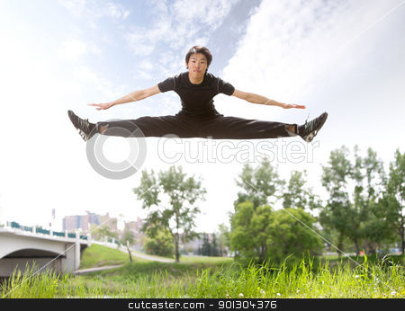 Man jumping in the air stock photo, Young man jumping in the air near bridge under clear sky by Tyler Olson