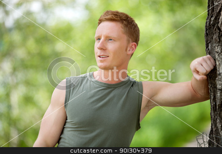 Man smiling and looking away stock photo, Close-up of a man smiling, looking away against blur background by Tyler Olson