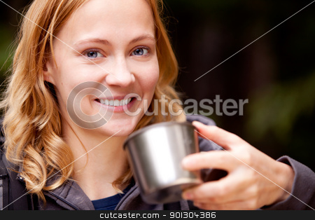 Woman Portrait Outdoor stock photo, A young beautiful woman outdoors on a campnig trip taking a drink by Tyler Olson