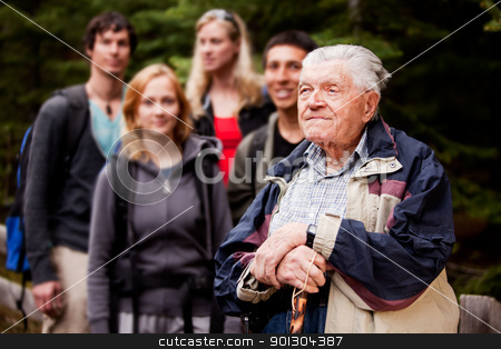 Elderly Man Tour Guide stock photo, An elderly man giving a tour for a young group of people by Tyler Olson