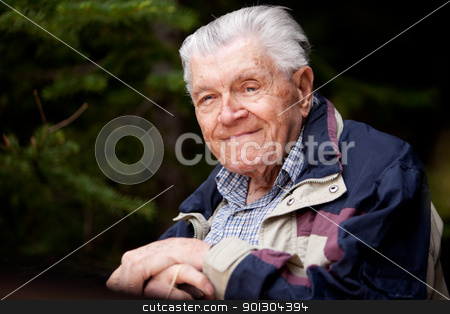 Portrait Elderly Man stock photo, A portrait of an elderly man resting in the forest. by Tyler Olson