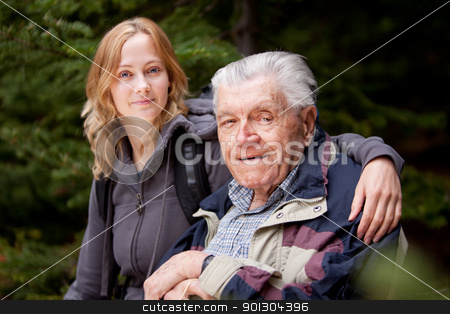 Grandfather Granddaughter stock photo, A portrait of a granddaughter with her grandfather in the forest by Tyler Olson
