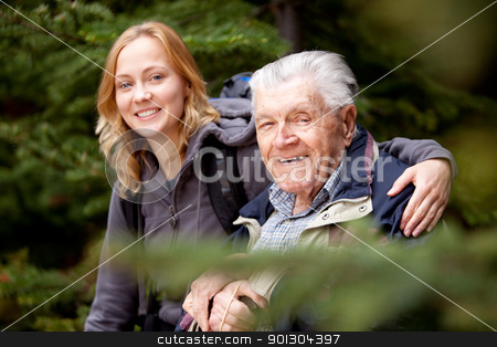 Portrait Grandfather Granddaughter stock photo, A portrait of a granddaughter and grandfather.  Shallow depth of field, focus on grandfather. by Tyler Olson