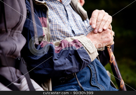 Elderly Man Outdoor stock photo, A detail of an elderly man outdoors with a walking stick by Tyler Olson