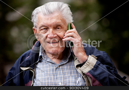 Senior Cell Phone stock photo, A portrait of a senior using a cell phone outdoors by Tyler Olson