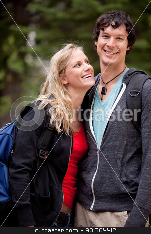 Man Woman Hike stock photo, A man and woman outdoors on a hike in a forest by Tyler Olson