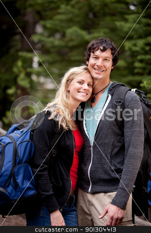 Happy Camping Couple stock photo, A young man and woman outdoors in the forest by Tyler Olson