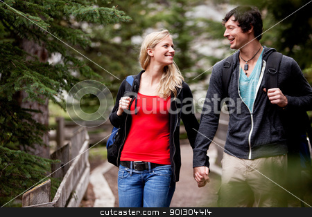 Outdoor Forest Walk stock photo, A young mand and woman walking in the forest by Tyler Olson
