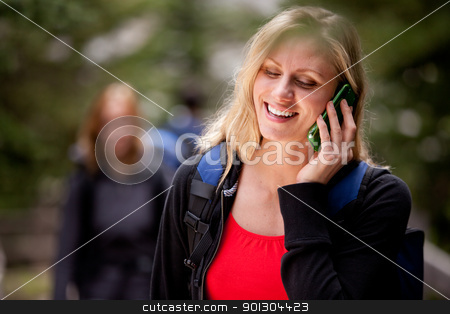 Happy Woman Cell Phone stock photo, A happy woman talking on a cell phone outdoors by Tyler Olson