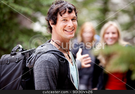 Man on Hike Waiting stock photo, A man is waiting for a girl on an outdoor hike by Tyler Olson