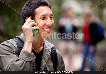 Talk Phone Outdoor stock photo, A man talking on a cell phone outdoors by Tyler Olson