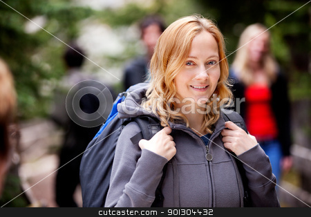 Outdoor Woman stock photo, A happy woman camper outdoors in the forest by Tyler Olson