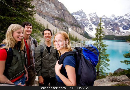Camping Friends in Mountains stock photo, A group of friends on a hiking / camping trip in the mountains by Tyler Olson