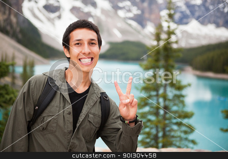 Male hiker showing you the 'V' sign stock photo, Happy male hiker showing you the victory sign against natural background by Tyler Olson