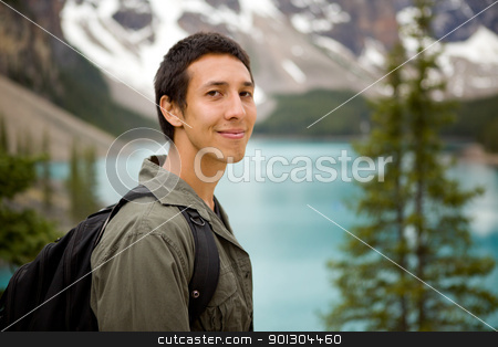 Happy Hiker Portrait stock photo, A portrait of a man outdoors on a hiking trip by Tyler Olson