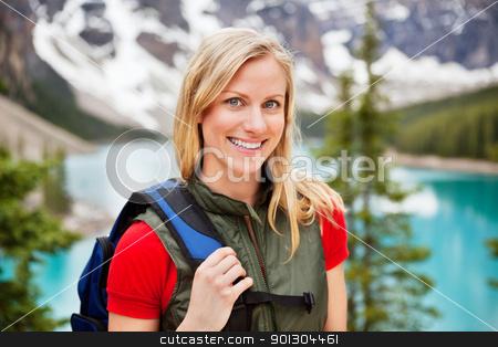 Beautiful female hiker smiling stock photo, Portrait of happy beautiful female hiker smiling by Tyler Olson