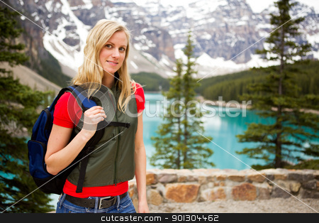 Hiking Portrait  stock photo, A portrait of a woman hiking on a mountain path near a lake by Tyler Olson