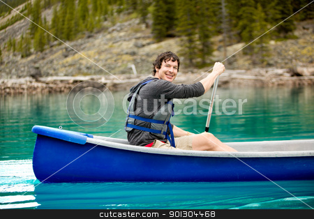 Man Canoe Portrait stock photo, A portrait of a smiling man in a canoe on a glacial lake by Tyler Olson