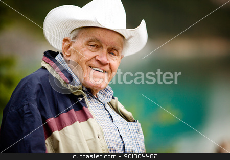 Elderly Man Portrait stock photo, A portrait of a happy elderly man with cowboy hat by Tyler Olson