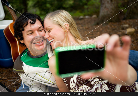 Self Portrait Outdoor Couple stock photo, A happy playful couple on a picnic taking a self portrait by Tyler Olson