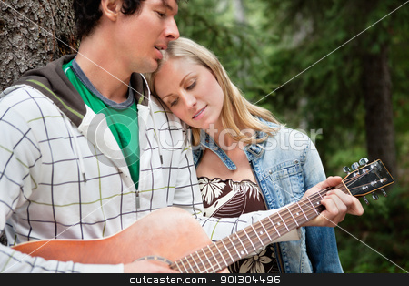 Man playing the guitar stock photo, Romantic couple with man playing the guitar by Tyler Olson