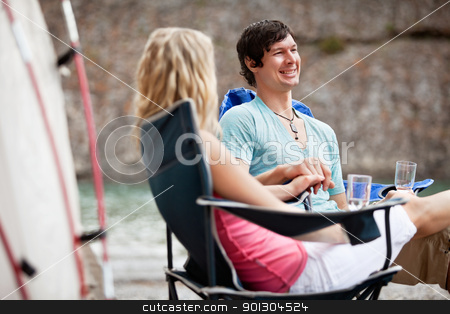 Young couple enjoying the vacation stock photo, Young couple holding hands and enjoying the vacation by Tyler Olson