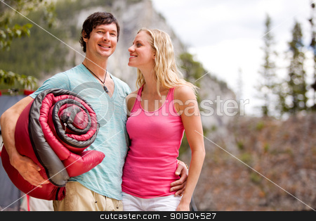 Camping Couple stock photo, A happy couple camping in the wilderness by Tyler Olson