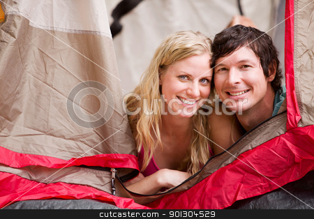 Summer Camping Couple stock photo, A portrait of a couple smiling in a tent by Tyler Olson