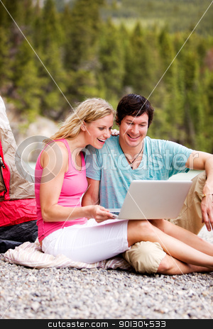 Laptop Outdoor Couple Camping stock photo, A couple using a laptop while on a camping trip by Tyler Olson