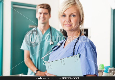 Confident female and male veterinarian stock photo, Portrait of confident female and male veterinarian by Tyler Olson