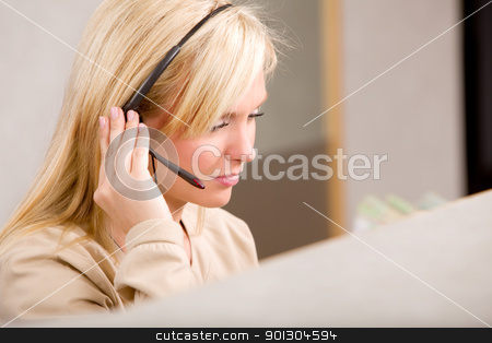 Receptionist with Phone Headset stock photo, A receptionist talking on the phone with a headset by Tyler Olson