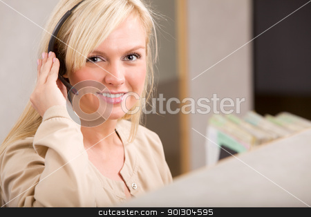 Receptionist stock photo, A happy receptionist with a phone headset by Tyler Olson