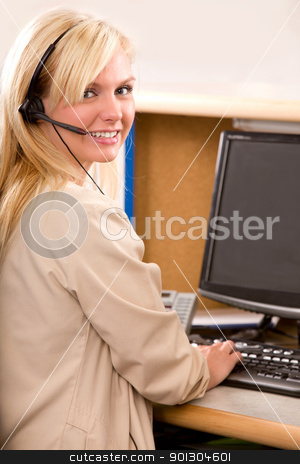 Receptionist with Headset stock photo, A happy bonde recpetionist with a phone headset by Tyler Olson