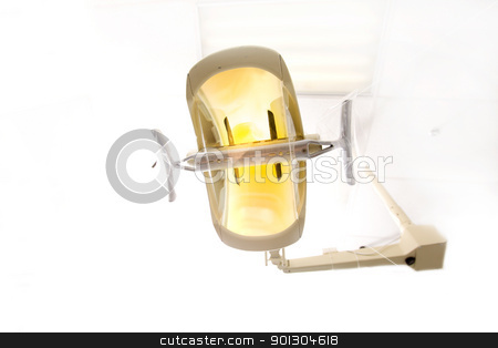 Dentist Light stock photo, A dentist light or lamp against the ceiling of the room by Tyler Olson