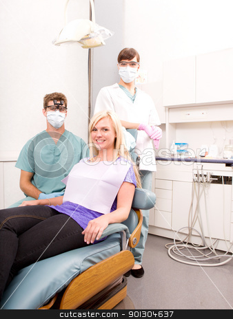 Dental Clinic with Patient stock photo, A dentist, assistant and patient in a dental clinic by Tyler Olson