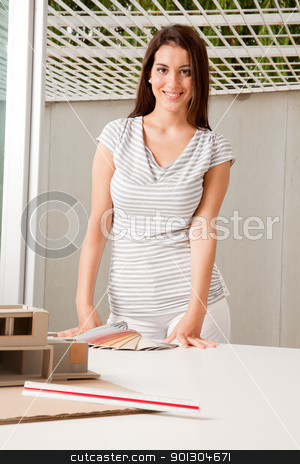 Architect with Color Swatches stock photo, A young female architect with color swatches and a rough model by Tyler Olson