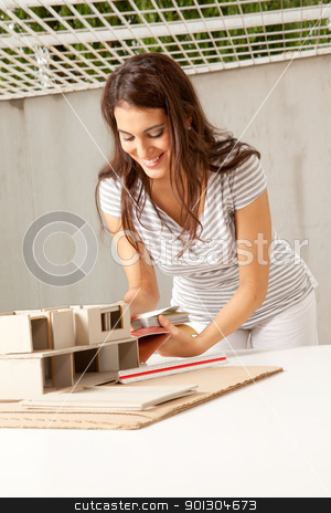 Young Female Architect stock photo, A young female architect choosing color swatches for a building by Tyler Olson