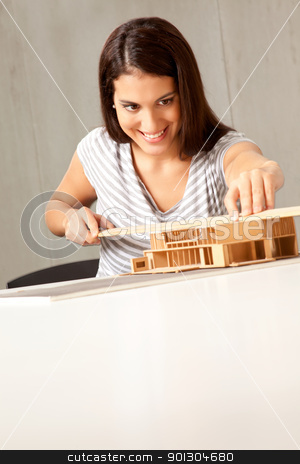 House Design Architect stock photo, A young architect designing and building a model house by Tyler Olson
