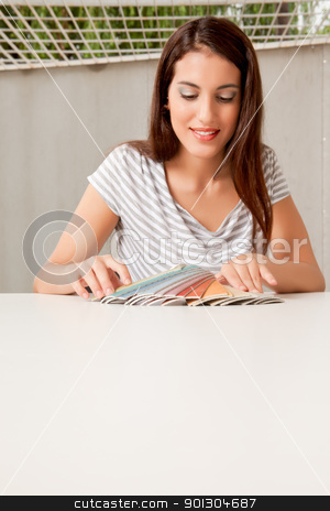 Interior Designer stock photo, A female interior designer with a group of color swatches by Tyler Olson