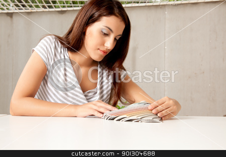 Design Color Swatches stock photo, A female interior designer looking at color swatches by Tyler Olson